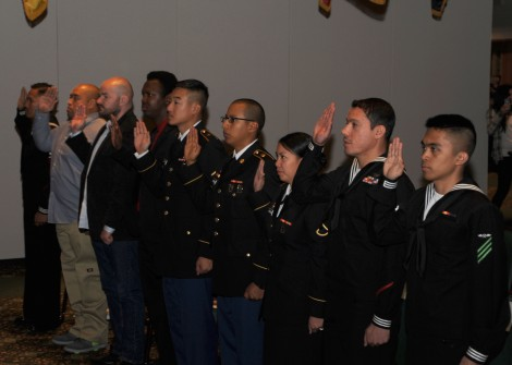 141107-N-EC099-073 JOINT BASE LEWIS-MCCHORD, Wash. (Nov. 7, 2014) Ð Service members recite the Oath of Allegiance during a Naturalization Ceremony held at Joint Base Lewis-McChord. This is the 7th annual ceremony to welcome service members who are also immigrants to become U.S. citizens.  (U.S. Navy photo by Mass Communication Specialist 3rd Class Charles D. Gaddis IV/Released)