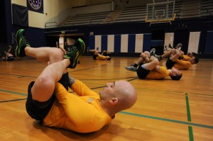 141107-N-OO032-272 BREMERTON, Wash. (Nov. 7, 2014) Electronics Technician 1st Class Gilberto Ivan Serranocordero, a Bayamon, P.R. native, performs a piriformis stretch during a Command Fitness Leader Course at Naval Base Kitsap's Concourse West Fitness and Aquatics Center The course entailed 40 hours of instruction regarding administrative procedures, conducting a Navy Physical Fitness Assessment (PFA), Fitness Enhancement Program and how to prepare Sailors utilizing various Navy tools and resources for the PFA and administrative duties. (U.S. Navy photo by Mass Communication Specialist 2nd Class Cory Asato/Released)