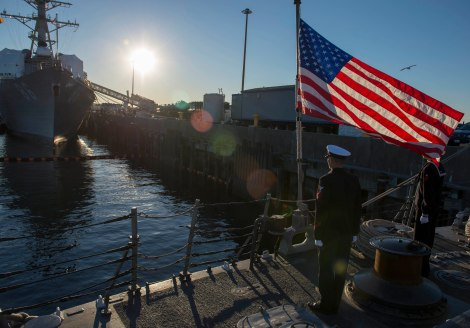 141112-N-MN975-039 EVERETT, Wash. (November 12, 2014) Sailors assigned to the Oliver Hazard Perry-class Frigate USS Ingraham (FFG 61) prepare to haul down ship's colors during a decommissioning ceremony. Ingraham was decommissioned after 25 years of Naval service. (U.S. Navy photo by Mass Communication Specialist 2nd Class Justin A. Johndro/RELEASED)