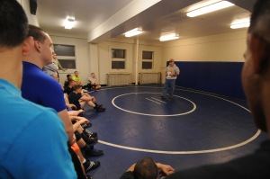 141113-N-OO032-008 BREMERTON, Wash. (Nov. 13, 2014) Rob Hermann, head coach of greco roman wrestling at Northern Michigan University and All Navy Wrestling scout, delivers opening remarks to 23 Navy Region Northwest service members at Naval Base Kitsap-Bremerton's Concourse West Fitness & Aquatics Center for the 2015 All Navy Wrestling Camp tryouts. Hermann assessed their wrestling skills from the neutral, top and bottom positions against opponents of similar sizes. (U.S. Navy photo by Mass Communication Specialist 2nd Class Cory Asato/Released)