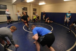 141113-N-OO032-023 BREMERTON, Wash. (Nov. 13, 2014) Navy Region Northwest service members warm up in preparation for the 2015 All Navy Wrestling Mini Camp tryouts at Naval Base Kitsap-Bremerton's Concourse West Fitness & Aquatics Center. The wrestlers showcased their skills from the neutral, top and bottom positions against opponents of similar sizes. (U.S. Navy photo by Mass Communication Specialist 2nd Class Cory Asato/Released)
