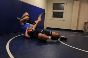 141113-N-OO032-156 BREMERTON, Wash. (Nov. 13, 2014) U.S. Coast Guard Boatswain's Mate 3rd Class Daniel Mazzei, a Hagerstown, Md. native, executes a head and arms roll during the 2015 All Navy Wrestling Mini Camp tryouts at Naval Base Kitsap-Bremerton's Concourse West Fitness & Aquatics Center. The wrestlers showcased their skills from the neutral, top and bottom positions against opponents of similar sizes. (U.S. Navy photo by Mass Communication Specialist 2nd Class Cory Asato/Released)