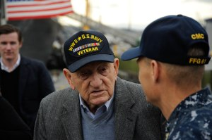 141126-N-AI901-100  EVERETT, Wash. (Nov. 26, 2014)   World War II veteran Sebastian Amato speaks with USS Ingraham Command Master Chief Dewey Torres as he arrived aboard the Oliver Hazard Perry class frigate for a tour. Amato served in the Pacific and participated in the Battles of Iwo Jima and Leyte Gulf. (U.S. Navy photo by Senior Chief Mass Communication Specialist Eric J. Harrison/RELEASED)