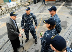 141126-N-AI901-105  EVERETT, Wash. (Nov. 26, 2014)   World War II veteran Sebastian Amato speaks with USS Ingraham Sailors as he arrived aboard the Oliver Hazard Perry class frigate for a tour. Amato served in the Pacific and participated in the Battles of Iwo Jima and Leyte Gulf. (U.S. Navy photo by Senior Chief Mass Communication Specialist Eric J. Harrison/RELEASED)