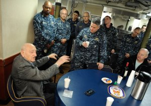 141126-N-AI901-121  EVERETT, Wash. (Nov. 26, 2014)   World War II veteran Sebastian Amato speaks with USS Ingraham Commanding Officer Cmdr. Daniel Straub, and the ship's wardroom and chiefs mess in the wardroom aboard the Oliver Hazard Perry class frigate. Amato served in the Pacific and participated in the Battles of Iwo Jima and Leyte Gulf. (U.S. Navy photo by Senior Chief Mass Communication Specialist Eric J. Harrison/RELEASED)