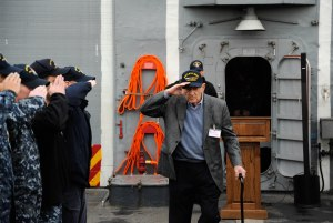 141126-N-AI901-129  EVERETT, Wash. (Nov. 26, 2014)   World War II veteran Sebastian Amato renders a hand salute as he passes through sideboys on the flight deck of USS Ingraham, following a tour of the Oliver Hazard Perry class frigate. Amato served in the Pacific and participated in the Battles of Iwo Jima and Leyte Gulf. (U.S. Navy photo by Senior Chief Mass Communication Specialist Eric J. Harrison/RELEASED)