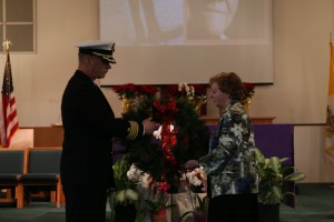 141207-N-DC740-032 OAK HARBOR, Wash. (Dec. 7, 2014) Capt. Mike Nortier, commanding officer of Naval Air Station Whidbey Island (NASWI), and Gayle Vyskocil, widow of Pearl Harbor survivor Lt. Cmdr. James Vyskocil and vice president of the North Cascade chapter of the Pearl Harbor Survivors Association, lay the remembrance wreath during the Pearl Harbor Commemoration held in the chapel of NASWI. The event marked the 73rd anniversary of the Dec. 7, 1941 Japanese attack on Pearl Harbor. (U.S. Navy photo by Mass Communication Specialist 2nd Class John Hetherington/Released)