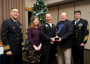 141202-N-EC099-016 SILVERDALE, Wash. (Dec. 09, 2014) Naval Base Kitsap (NBK) Command Master Chief David Lynch, NBK Commanding Officer Capt. Thomas Zwolfer and Olympic Navy League President Larry Salter present Master-at-Arms 3rd Class James Lupo IV, from Cincinnati, Ohio, with the Junior Sailor of the Year Award. The Olympic Navy League hosted a luncheon to award the 2014 Sailors of the Year from Naval Base Kitsap. (U.S. Navy photo by Mass Communication Specialist 3rd Class Charles D. Gaddis IV/Released)