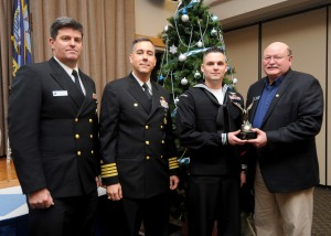 141202-N-EC099-020 SILVERDALE, Wash. (Dec. 09, 2014) Naval Base Kitsap (NBK) Command Master Chief David Lynch, NBK Commanding Officer Capt. Thomas Zwolfer and Olympic Navy League President Larry Salter present Aviation Boatswain's Mate (Equipment) 2nd Class Troy Cloe Jr., from Pana, Ill, with the Sailor of the Year Award. The Olympic Navy League hosted a luncheon to award the 2014 Sailors of the Year from Naval Base Kitsap. (U.S. Navy photo by Mass Communication Specialist 3rd Class Charles D. Gaddis IV/Released)
