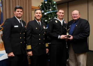 141202-N-EC099-024 SILVERDALE, Wash. (Dec. 09, 2014) Naval Base Kitsap (NBK) Command Master Chief David Lynch, NBK Commanding Officer Capt. Thomas Zwolfer and Olympic Navy League President Larry Salter present Master-at-Arms 1st Class Jason Stafford, from Houston with the Senior Sailor of the Year Award. The Olympic Navy League hosted a luncheon to award the 2014 Sailors of the Year from Naval Base Kitsap. (U.S. Navy photo by Mass Communication Specialist 3rd Class Charles D. Gaddis IV/Released)