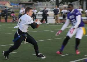 141212-N-ZY850-026 TACOMA, Wash. (Dec. 12, 2014) Team Navy's Master-at-Arms 2nd Class John Juhl, assigned to Marine Corps Security Force Battalion, runs for the end zone during 15th annual Army vs. Navy flag football game at Joint Base Lewis-McChord's Cowan Stadium in Tacoma, Wash., Dec. 12. Navy defeated Army 24-9. (U.S. Navy photo by Mass Communication Specialist 2nd Class Jamie Hawkins/Released)
