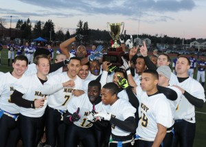 141212-N-ZY850-080 TACOMA, Wash. (Dec. 12, 2014) Members of Team Navy raise the game trophy in celebration after the 15th annual Army vs. Navy flag football game at Joint Base Lewis-McChord's Cowan Stadium in Tacoma, Wash., Dec. 12. Navy defeated Army 24-9. (U.S. Navy photo by Mass Communication Specialist 2nd Class Jamie Hawkins/Released)
