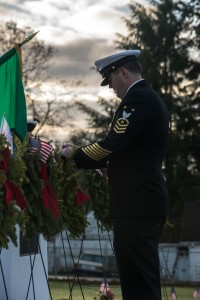 141213-N-JY507-016 BREMERTON, Wash. (Dec. 13, 2014) – Command Master Chief David Lynch, from Lewis Town, Mont. places a small flag upon the wreath dedicated to the Navy during a wreath laying ceremony at Bremerton, Wash. Ivy Green Cemetery Dec. 13. The ceremony was held by Wreaths Across America and Navy Wives Club of America Kitsap 46 to commemorate all the military members who have given their lives in service to our country. (U.S. Navy photo by Mass Communication Specialist 3rd Class Seth Coulter/ Released)