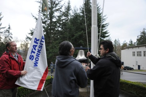 141217-N-OO032-063 CHIMACUM, Wash. (Dec. 17, 2014) (left to right) Joseph Walther, Shirley Lentz and Arturo Trevino, all Naval Magazine Indian Island personnel, raise a Voluntary Protection Program Star flag at the command office building commemorating becoming a VPP Star partner. The VPP recognize employers and workers in the private industry and federal agencies who have implemented effective safety and health management systems and maintain injury and illness rates below national Bureau of Labor Statistics averages for their respective industries. (U.S. Navy photo by Mass Communication Specialist 2nd Class Cory Asato/Released)