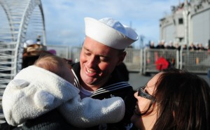 141219-N-MM360-221 EVERETT, Wash. (Dec. 19, 2014) – Navy Counselor 1st Class Erik Johnson, a native of Colorado Springs, Colo. assigned to the Oliver Hazard Perry-class guided-missile frigate USS Rodney M. Davis (FFG 60), sees his new baby for the first time after completing a six-month deployment. Rodney M. Davis returned from its final deployment to the Western Pacific and Indian Ocean to her homeport at Naval Station Everett Dec. 19 and will prepare to decommission in 2015. (U.S. Navy photo by Mass Communication Specialist 1st Class Jeffry A. Willadsen/Released)