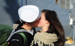141219-N-MM360-239 EVERETT, Wash. (Dec. 19, 2014) –Operations Specialist 2nd Class Benjamin Stephenson, a native of Everett, Wash. assigned to the Oliver Hazard Perry-class guided-missile frigate USS Rodney M. Davis (FFG 60), kisses his wife Emilia after completing a six-month deployment. Rodney M. Davis returned from its final deployment to the Western Pacific and Indian Ocean to her homeport at Naval Station Everett Dec. 19 and will prepare to decommission in 2015. (U.S. Navy photo by Mass Communication Specialist 1st Class Jeffry A. Willadsen/Released)