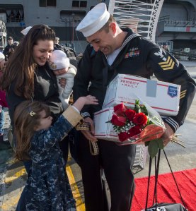 141219-N-MN975-033 EVERETT, Wash. (Dec. 19, 2014) A Sailor assigned to the Oliver Hazard Perry-class guided-missile frigate USS Rodney M. Davis (FFG 60), greets his family on the pier after completing a six-month deployment. Rodney M. Davis returned from its final deployment to the Western Pacific and Indian Ocean to her homeport at Naval Station Everett Dec. 19 and will prepare to decommission in 2015. (U.S. Navy photo by Mass Communication Specialist 2nd Class Justin A. Johndro/RELEASED)