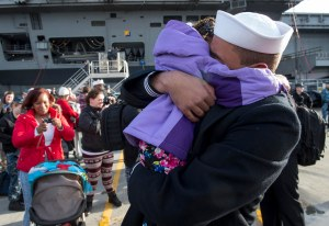 141219-N-MN975-038 EVERETT, Wash. (Dec. 19, 2014) Seaman Anthony Robinson, a native of Stilwater, Penn. assigned to the Oliver Hazard Perry-class guided-missile frigate USS Rodney M. Davis (FFG 60), hugs his daughter after completing a six-month deployment. Rodney M. Davis returned from its final deployment to the Western Pacific and Indian Ocean to her homeport at Naval Station Everett Dec. 19 and will prepare to decommission in 2015. (U.S. Navy photo by Mass Communication Specialist 2nd Class Justin A. Johndro/RELEASED)