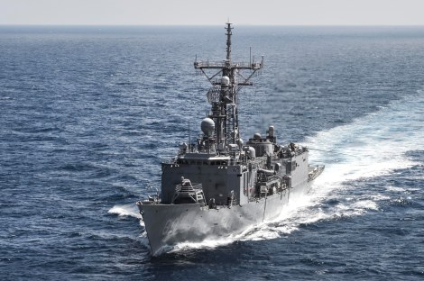 INDIAN OCEAN (Oct. 4, 2014) The Oliver Hazard Perry-class guided-missile frigate USS Rodney M. Davis (FFG 60) departs from a replenishment-at-sea with the Military Sealift Command fleet replenishment oiler USNS Tippecanoe (T-AO 199). Rodney M. Davis is on patrol in the Indian Ocean in support of regional security and stability. (U.S. Navy photo by Mass Communication Specialist 3rd Class Derek A. Harkins/Released)