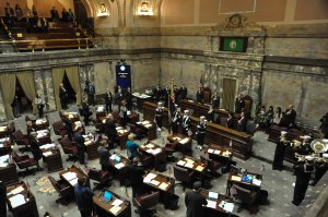 150211-N-EC099-059 OLYMPIA, Wash. (Feb. 11, 2015) – Navy Region Northwest's Honor Guard parade the colors in the Washington State Senate House of Representatives during Navy Day. Washington State Senators discuss the importance of celebrating the U.S. Navy and their achievements. (US Navy photo by Mass Communication Specialist 3rd Class Charles D. Gaddis IV/Released)