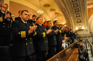 150211-N-EC099-168 OLYMPIA, Wash. (Feb. 11, 2015) – Sailors assigned to Commander, Submarine Group 9 (COMSUBGRU 9) applaud the award recipients in the Washington State Senate House of Representatives during Navy Day. Washington State Senators discuss the importance of celebrating the U.S. Navy and their achievements. (US Navy photo by Mass Communication Specialist 3rd Class Charles D. Gaddis IV/Released)