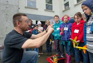 150212-N-MN975-001 BREMERTON, Wash. (Feb. 12, 2015) Steve Mastel, a marine technician at Puget Sound Naval Shipyard, helps students from Wilkes Elementary School with protracting a correct angle to launch their paper tube rockets during a Science, Technology, Engineering and Math (STEM) day at Puget Sound Naval Museum. The STEM program was implemented to show younger generations there are exciting jobs in the science and technology fields and to help foster the growth of future scientists for America. (U.S. Navy photo by Mass Communication Specialist 2nd Class Justin A. Johndro/RELEASED)