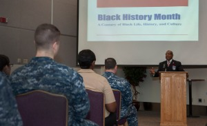 150220-N-MM360-044 EVERETT, Wash. (Feb. 20, 2015) – Raymond Miller, the former vice president of the Snohomish County branch chapter of the National Association for the Advancement of Colored People (NAACP) and Air Force veteran, speaks during the National African-American History Month celebration in the Grand Vista Ballroom on Naval Station Everett (NSE). The ceremony, meant to recognize the impact African-Americans have had on both American and naval history, included a guest speaker, multimedia presentations, a poetry reading and a static display on black history. (U.S. Navy photo by Mass Communication Specialist 1st Class Jeffry A. Willadsen/Released)