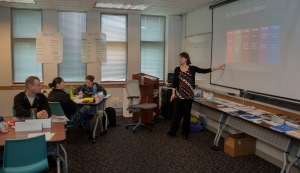 "150225-N-MM360-038 EVERETT, Wash. (Feb. 25, 2015) – Kahlia Sullen, a Personal Financial Management Specialist with the Fleet and Family Support Center, teaches a ""Million Dollar Sailor"" Class on Naval Station Everett (NSE). The class, meant to teach Sailors about financial management and retirement planning, is part of Military Saves Week on NSE, an event designed to encourage financial planning and fiscal responsibility. (U.S. Navy photo by Mass Communication Specialist 1st Class Jeffry A. Willadsen/Released)"