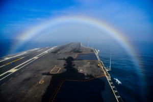 150203-N-TC437-198  PACIFIC OCEAN (Feb. 3, 2015) A rainbow forms over the bow of the Nimitz-class aircraft carrier USS John C. Stennis (CVN 74). John C. Stennis is undergoing an operational training period in preparation for future deployments. (U.S. Navy photo by Mass Communication Specialist 3rd Class Ignacio D. Perez/Released)
