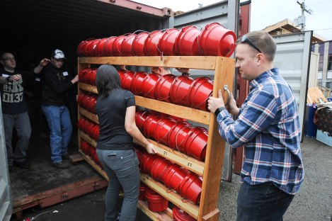 150226-N-OO032-206 BREMERTON, Wash. (Feb. 26, 2015) -- Marine Corps Security Force Battalion (MCSFBn) Bangor Sailors and Marines load Salvation Army donation buckets in a trailer at The Salvation Army of Bremerton as part of the command's monthly volunteer venues coordinated through their chaplain's office. MCSFBn personnel have accumulated approximately 8,500 hours of community service throughout the last year while averaging about 50 volunteers spread between the Bremerton Foodline food bank, the Salvation Army of Bremerton and at both the Habitat for Humanity of Kitsap County store and construction sites each month. (U.S. Navy Photo by Mass Communication Specialist 2nd Class Cory Asato/Released)