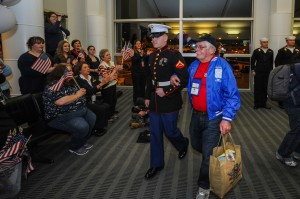150316-N-EC099-168 SEA-TAC, Wash. (Mar. 16, 2015) – A Marine escorts an honored World War II veteran through active duty service members during the arrival from Puget Sound Honor Flights. Honor Flight Network is a non-profit organization created solely to honor America's veterans for all their sacrifices. (US Navy photo by Mass Communication Specialist 3rd Class Charles D. Gaddis IV/Released)
