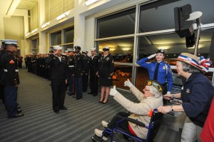 150316-N-EC099-214 SEA-TAC, Wash. (Mar. 16, 2015) – A Sailor salutes an honored World War II veteran through active duty service members during the arrival from Puget Sound Honor Flights. Honor Flight Network is a non-profit organization created solely to honor America's veterans for all their sacrifices. (US Navy photo by Mass Communication Specialist 3rd Class Charles D. Gaddis IV/Released)