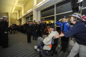 150316-N-EC099-240 SEA-TAC, Wash. (Mar. 16, 2015) – A Sailor salutes an honored World War II veteran through active duty service members during the arrival from Puget Sound Honor Flights. Honor Flight Network is a non-profit organization created solely to honor America's veterans for all their sacrifices. (US Navy photo by Mass Communication Specialist 3rd Class Charles D. Gaddis IV/Released)