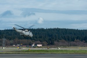 150324-N-WQ574-180 OAK HARBOR, Wash. (March 24, 2015) A Royal Canadian Air Force (RCAF) CH-124 Sea King, attached to 443 Maritime Helicopter Squadron, departs Ault Field during a joint training exercise with Naval Air Station Whidbey Island (NASWI) Search and Rescue (SAR) at NASWI. RCAF and SAR perform biannual training to enhance cooperation for joint rescue efforts. (U.S. Navy photo by Mass Communication Specialist 3rd Class Caleb Cooper/Released)
