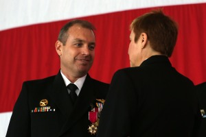 150402-N-DC740-035 OAK HARBOR, Wash. (April 2, 2015) Rear Adm. Sandy Daniels, Commander, Patrol and Reconnaissance Group and Patrol and Reconnaissance Group Pacific, right, presents Capt. Vincent W. Segars with the Legion of Merit during a change of command ceremony at Naval Air Station Whidbey Island. Capt. Brett Mietus relieved Segars during the Patrol and Reconnaissance Wing (CPRW) 10 change of command ceremony.  (U.S. Navy photo by Mass Communication Specialist 2nd Class John Hetherington/Released)