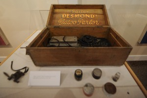"150403-N-OO032-009 BREMERTON, Wash. (April 3, 2015) -- An antique tattoo kit estimated to date from the 1920s on display at the Puget Sound Navy Museum's naval heritage tattoo exhibit ""Skin Deep: The Nautical Roots of Tattoo Culture."" The exhibit showcases how the history of Sailors and nautical culture in the U.S. and British Royal Navies are closely intertwined from the 1800s through the present. (U.S. Navy photo by Mass Communication Specialist 2nd Class Cory Asato/Released)"