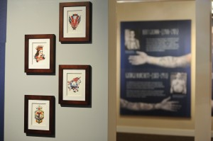 "150403-N-OO032-014 BREMERTON, Wash. (April 3, 2015) -- American Traditional tattoo flashes on display at the Puget Sound Navy Museum's naval heritage tattoo exhibit ""Skin Deep: The Nautical Roots of Tattoo Culture."" The exhibit showcases how the history of Sailors and nautical culture in the U.S. and British Royal Navies are closely intertwined from the 1800s through the present. (U.S. Navy photo by Mass Communication Specialist 2nd Class Cory Asato/Released)"
