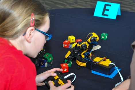 150416-N-EC099-094 BREMERTON, Wash. (Apr. 16, 2015) A Poulsbo Elementary School student operates a robotic arm during a Science, Technology, Engineering and Mathematics (STEM) Fair at the Puget Sound Navy Museum. The STEM Fair was hosted by Puget Sound Navy Museum, Naval Undersea Museum and the Puget Sound Naval Shipyard. (U.S. Navy photo by Mass Communication Specialist 3rd Class Charles D. Gaddis IV/Released)