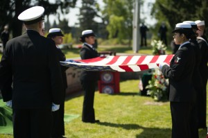 150418-N-JY507-029 TACOMA, Wash. (April 18, 2015) – Members of the Navy Region Northwest Honor Guard hold the American flag during a funeral service for Lt. j.g. Richard C. Clark at Mountain View Funeral Home Tacoma, Washington April 18. He was shot down over the Vinh Phuc Province, Vietnam, Oct. 24, 1967 while on a combat air patrol mission. Clark, who could not be confirmed as having successfully ejected from the aircraft, was carried as missing in action until later changed to presumed killed in action. Jan. 16, 1991 the Socialist Republic of Vietnam repatriated 11 boxes of remains to the United States, which confirmed after DNA testing they contained Clark's remains in 2014. (U.S. Navy photo by Mass Communication Specialist 3rd Class Seth Coulter/ Released)