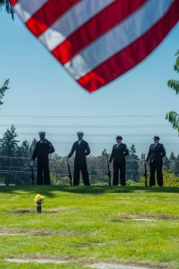150418-N-JY507-062 TACOMA, Wash. (April 18, 2015) – Members of the Navy Region Northwest Honor Guard stand at parade-rest during a funeral service for Lt. j.g. Richard C. Clark at Mountain View Funeral Home Tacoma, Washington April 18. He was shot down over the Vinh Phuc Province, Vietnam, Oct. 24, 1967 while on a combat air patrol mission. Clark, who could not be confirmed as having successfully ejected from the aircraft, was carried as missing in action until later changed to presumed killed in action. Jan. 16, 1991 the Socialist Republic of Vietnam repatriated 11 boxes of remains to the United States, which confirmed after DNA testing they contained Clark's remains in 2014.  (U.S. Navy photo by Mass Communication Specialist 3rd Class Seth Coulter/ Released)
