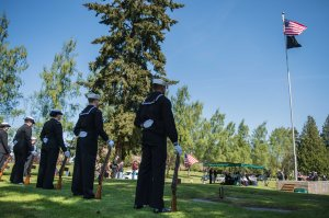 150418-N-JY507-065 TACOMA, Wash. (April 18, 2015) – Members of the Navy Region Northwest Honor Guard stand at parade-rest during a funeral service for Lt. j.g. Richard C. Clark at Mountain View Funeral Home Tacoma, Washington April 18. He was shot down over the Vinh Phuc Province, Vietnam, Oct. 24, 1967 while on a combat air patrol mission. Clark, who could not be confirmed as having successfully ejected from the aircraft, was carried as missing in action until later changed to presumed killed in action. Jan. 16, 1991 the Socialist Republic of Vietnam repatriated 11 boxes of remains to the United States, which confirmed after DNA testing they contained Clark's remains in 2014. (U.S. Navy photo by Mass Communication Specialist 3rd Class Seth Coulter/ Released)