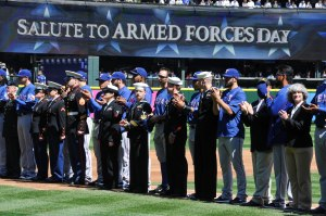 150419-N-OO032-065 SEATTLE (April 19, 2015) -- Submarine Group 9 Sailors stand along side Texas Rangers during the Seattle Mariners' 14th Annual Salute to Armed Forces at Safeco Field. A service member representing each of the five armed services threw a ceremonial first pitch. (U.S. Navy photo by Mass Communication Specialist 2nd Class Cory Asato/Released)