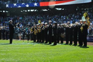 "150419-N-OO032-111 SEATTLE (April 19, 2015) -- Navy Band Northwest performs the ""National Anthem"" during the Seattle Mariners' 14th Annual Salute to Armed Forces at Safeco Field. A service member representing each of the five armed services threw a ceremonial first pitch. (U.S. Navy photo by Mass Communication Specialist 2nd Class Cory Asato/Released)"
