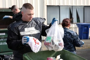 150421-N-DC740-028 OAK HARBOR, Wash. (April 21, 2015) Aviation Electronics Technician 3rd Class Dylan Krause, from Kalispell, Mont., assigned to Fleet Readiness Center Northwest, separates recyclables from trash during the 19th Annual Dumpster Dive at Naval Air Station Whidbey Island's recycling center. The Dumpster Dive is an opportunity to educate Sailors about recycling. (U.S. Navy photo by Mass Communication Specialist 2nd Class John Hetherington/Released)
