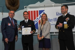 150515-N-EC099-037 BREMERTON, Wash. (May 15, 2015) Lt. Jim Mosimann, assigned to the aircraft carrier USS Nimitz (CVN 68), receives a certificate of merit from Military Officers Association of America Kitsap Chapter during their annual luncheon. The MOAA has been supporting the military for over 39 years.(U.S. Navy photo by Mass Communication Specialist 3rd Class Charles D. Gaddis IV/Released)