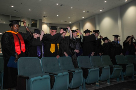 150521-N-EC099-157 KEYPORT, Wash. (May 21, 2015) – College graduates switch sides of their tassels during a college graduation in Naval Undersea Museum's Jack Murdock Auditorium. The Navy College Program has assisted Sailors and spouses for over 40 years. (U.S. Navy Photo by Mass Communication Specialist 3rd Class Charles W. Gaddis IV/Released)