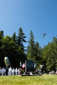 150610-N-JY507-073 GARDINER, Wash. (June 10, 2015) A MH-60S Seahawk helicopter flies over a ceremony commemorating the 50th anniversary of Medal of Honor recipient Marvin Shields actions in Vietnam. Sailors, members of the team and guests gathered at Gardiner Cemetery to remember his actions and heroism. (U.S. Navy Photo by Mass Communication Specialist 3rd Class Seth Coulter/Released)