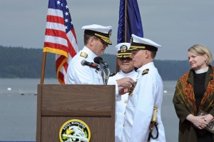 150611-N-OO032-157 PORT HADLOCK, Wash. (June 11, 2015) -- Rear Adm. Jeff Ruth, Commander Navy Region Northwest, pins Cmdr. Michael Yesunas, departing commanding officer of Naval Magazine Indian Island (NAVMAG), with a Meritorious Service Medal, his end of tour award, during NAVMAG's change-of-command ceremony. Beginning in August 2015, Yesunas will pursue a Master's Degree at the Dwight D. Eisenhower School for National Security and Resource Strategy at Fort Lesley J. McNair on the National Defense University campus. (U.S. Navy photo by Mass Communication Specialist 2nd Class Cory Asato/Released)