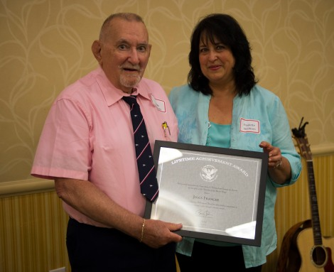 """150611-N-MN975-003 EVERETT, Wash. (June 11, 2015) Retired Master Chief Yeoman Francis A. """"Jiggs"""" Franchi receives the President's Volunteer Service Award. The award is given to those with more than 4,000 documented hours of volunteer service, it is also referred to as the President's Call to Service Lifetime Award. (U.S. Navy photo by Mass Communication Specialist 2nd Class Justin A. Johndro/RELEASED)"""