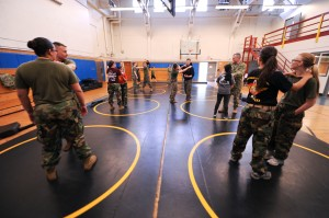 150612-N-OO032-086 SILVERDALE, Wash. (June 12, 2015) -- Family members of Sailors and Marines stationed at Marine Corps Security Force Battalion (MCSFBn) – Bangor, learn a wrist lock counter to a choke from MCSFBn Marine Corps Martial Arts Program instructors as a part of MCSFBn's Jayne Wayne Day at Naval Base Kitsap - Bangor. Jayne Wayne Day is an annual Marine Corps tradition engaging military spouses in various aspects of their Sailors' and Marines' lives on duty. (U.S. Navy photo by Mass Communication Specialist 2nd Class Cory Asato/Released)